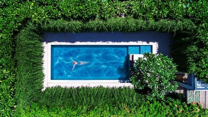 Wyndham Phú Quốc sở hữu kiến trúc go green nổi bật và khác biệt với những mảng xanh rộng lớn theo phong cách khu vườn nhiệt đới. Ảnh: Nam Group. - WikiLand  - w1-2911-1625476033 - Không gian nghỉ dưỡng hòa vào thiên nhiên tại Wyndham Phú Quốc